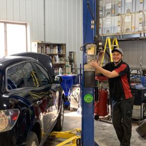 Prairie Du Chien mechanic repairing car transmission