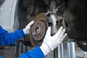Mechanic replacing brake pads and rotors