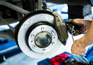 Mechanic repairing and replacing brakes