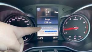 Mechanic reviewing car mileage